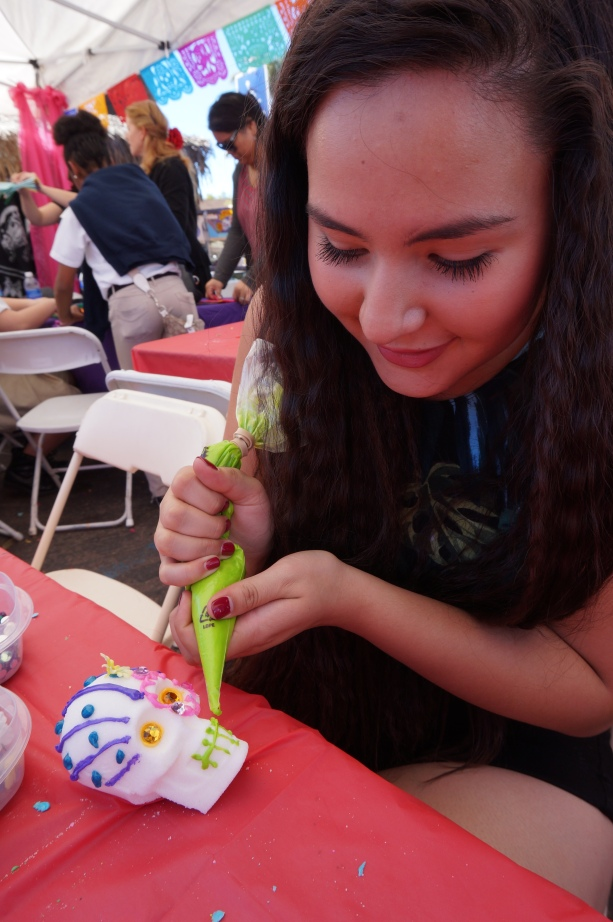 Use icing to design and bond other craft decorations on sugar skull